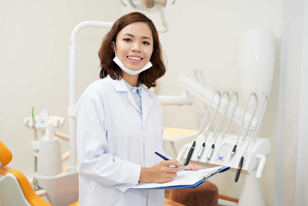 Female young dentist smiling