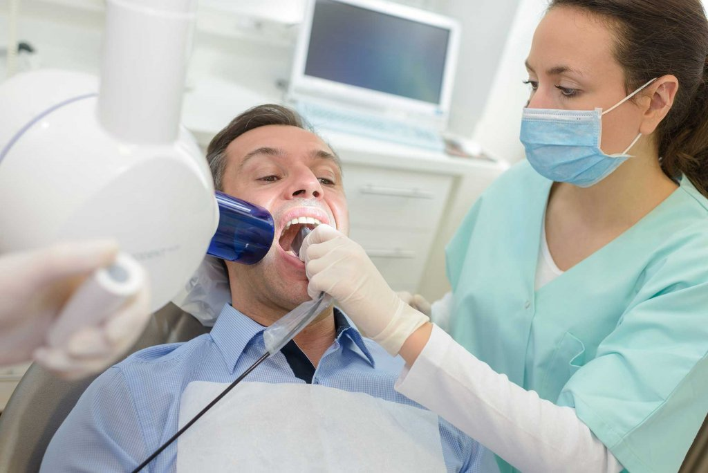 Dentist doing digital xray to a patient